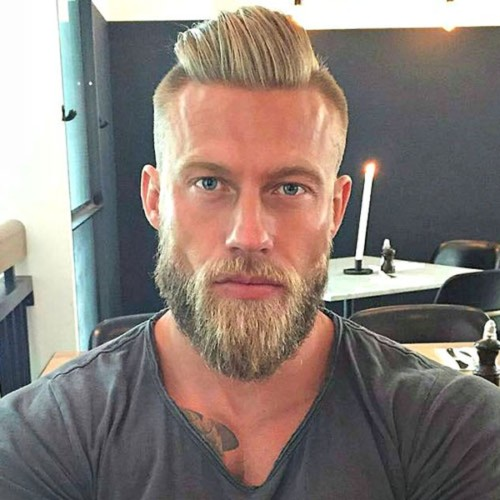 Slicked-Back-Hair-with-Undercut-and-Thick-Beard